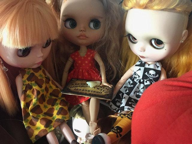 "Tammy Powley: ""Neo Blythe dolls are conjuring spirits around a Ouija board."""