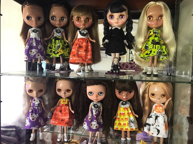 """Tammy Powley: """"An assortment of Neo Blythe dolls, stock and customized, wear Halloween-inspired dressed. The tiny doll is from Mrs. Frazzled. I made all but the Wednesday Addams dress."""""""