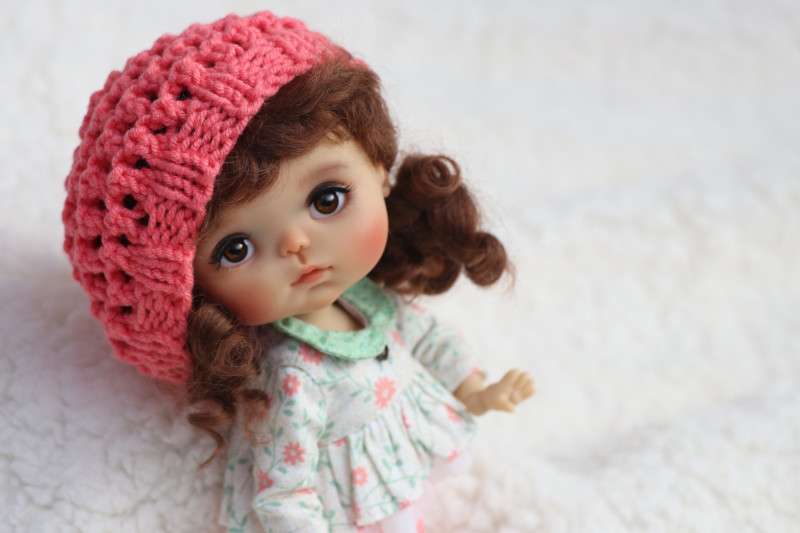 Fabbi is a 20 cm BJD cast in sunkissed resin on Meadow Dolls' Chibbi body. She's available exclusively from DOLLS magazine.