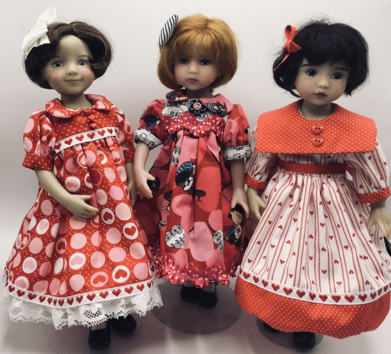 """Linda Strodtman: """"Three Little Darling dolls wear owner-made Valentine dresses. From left are Marilyn, Peggy Sue, and Baby Peggy. They are all set to celebrate the Valentine's holiday."""""""