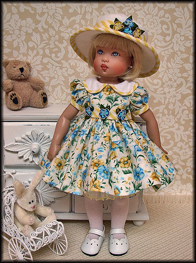 "Janis Kiker: ""Bitty Bethany by Kish Doll Co. is wearing her floral Easter dress and showing off her Easter bonnet."""
