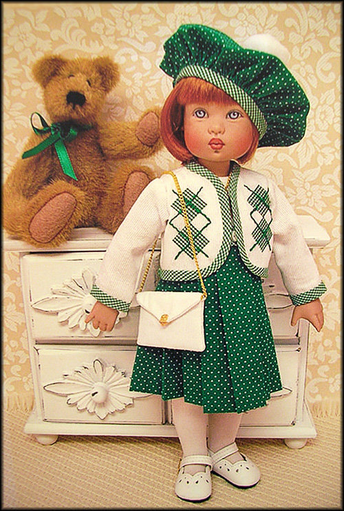 """Janis Kiker: """"Redhead Bitty Bethany by Helen Kish Doll Co. wears a custom-made fashion for St. Patrick's Day. Her friend is proudly wearing his bit of green in the bow around his neck, and they're ready for parade watching!"""""""