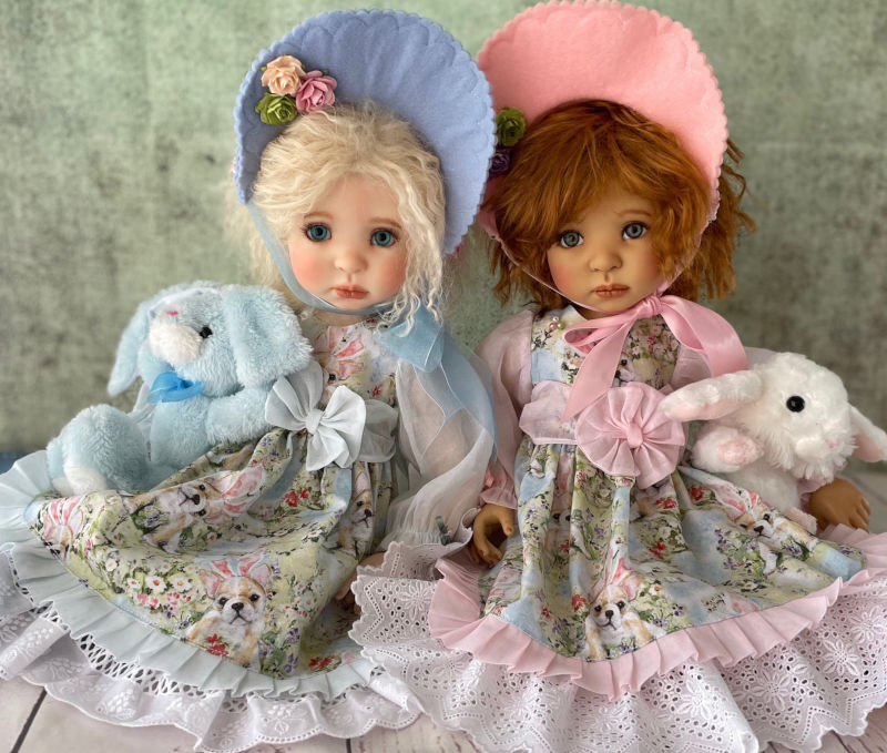 "Karen Kinyon: ""My Meadow Ardyn-Louise and Ardyn-Marie snuggle with their bunnies, wearing ensembles made by me."""