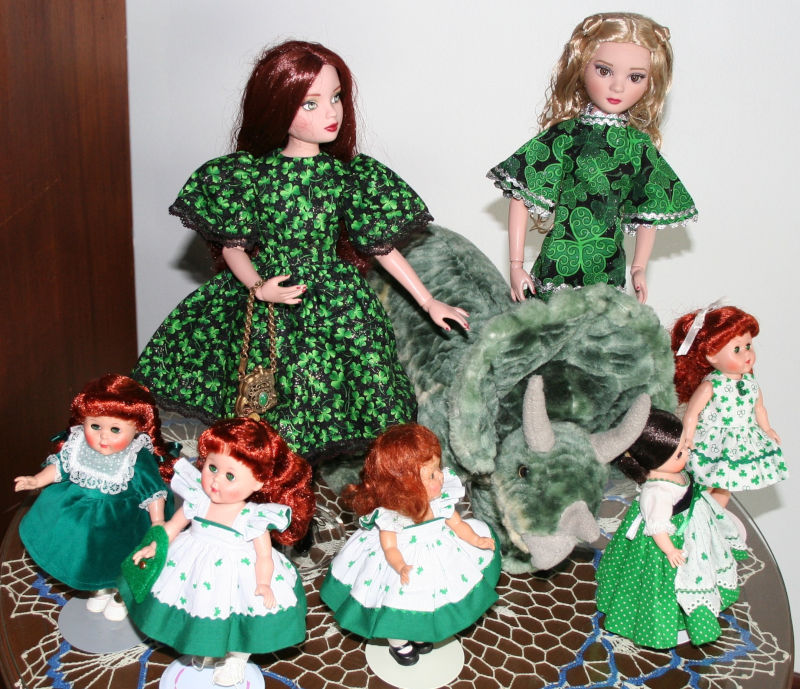 """Marsha Lynn Marquardt: """"El and Pru are in their St Pat's dresses made by Mom. They're with their pet dinosaur, Steggy (We thought he was a stegosaurus. Turns out he's a triceratops.) Three Ginnys and an MA have joined them."""""""