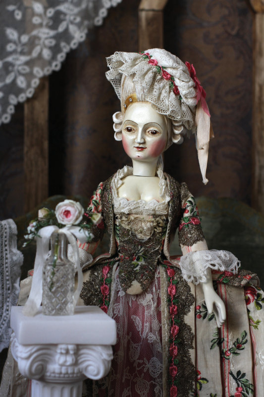 A 14-inch wooden doll dressed in French Court style by Mordvinkova.