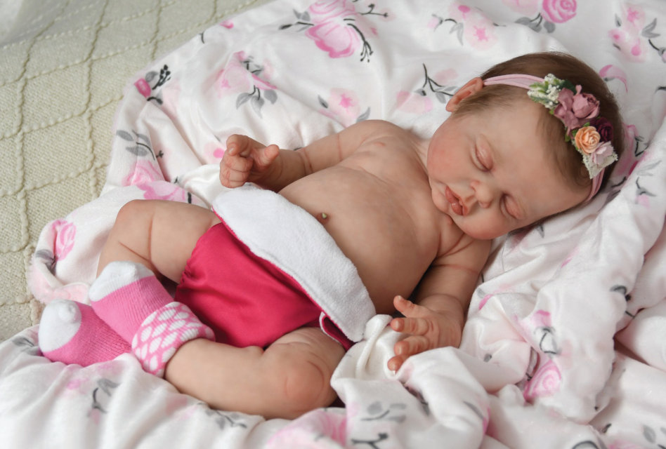 Johnnie, a full-body silicone baby sculpted by Ina Volprich, painted by Maria Lynn Grover.