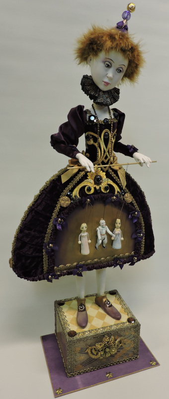 """Life is Like a Theatre, 25 inches. """"The little dolls on the skirt made me make this doll. Two of them I purchased in Prague and the middle one is a vintage German puppet from 1910. We all play our role in life, and we are the ones who can pull the threads!"""""""