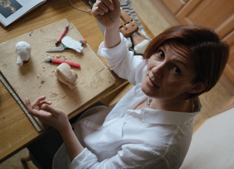 Mordvinkova works on her dolls.