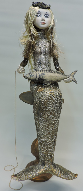 """More than a Mermaid, 25 inches. """"Like she really comes out of the water, that's why this Mermaid is colored in the silver-grey colors. Her silk hair also has to look like running water."""""""