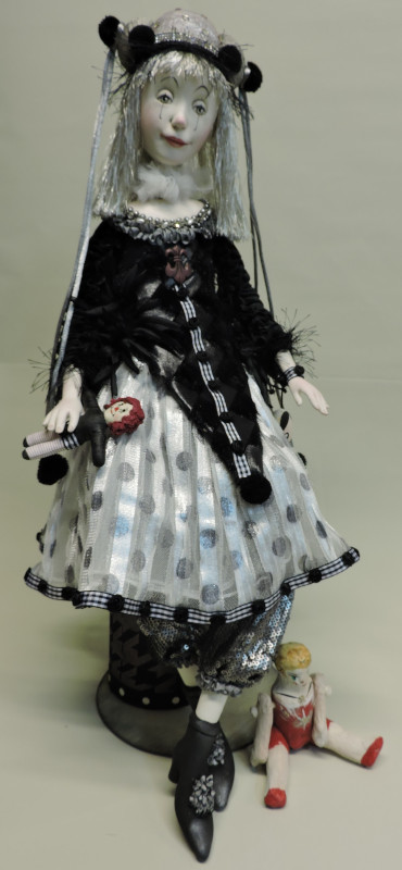 """Pierette, 22 inches. """"I very much love black and white colors. Even in my own clothes I love this! I used different styles of fabric for this girl. Very thin and very heavy fabrics. I wanted her hat to have a different shape. I added just one different color that pops out of the costume and matches her lip color."""""""
