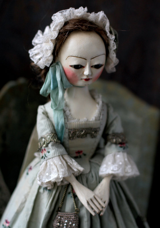 Mordvinkova's Queen Anne-style dolls are not reproductions; they are her own interpretation of the English wooden dolls made in the 17th and 18th centuries. Most are about 14 inches tall.