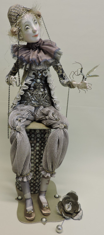 """Silver Lining, 24 inches. """"This doll is dressed in beautiful shades of gray. The decorations on the costume are mostly vintage embellishments."""""""