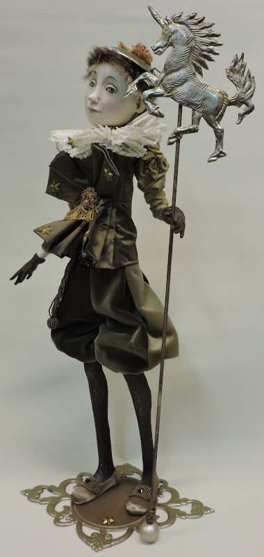 """Together on the Road, 21 inches. """"Mostly the fabrics inspire me to make a certain figure. I always try to make a costume I never did before. This costume is made with silks and velvets and lace; the horse is made out of wire."""""""