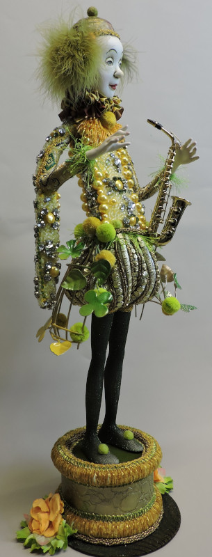 """Walking on the Bright Side, 28 inches. """"The making of this doll started with finding the beautiful evening dress in the yellow colors. I used an embroidered purse for the trousers and all kind of matching embellishments."""""""