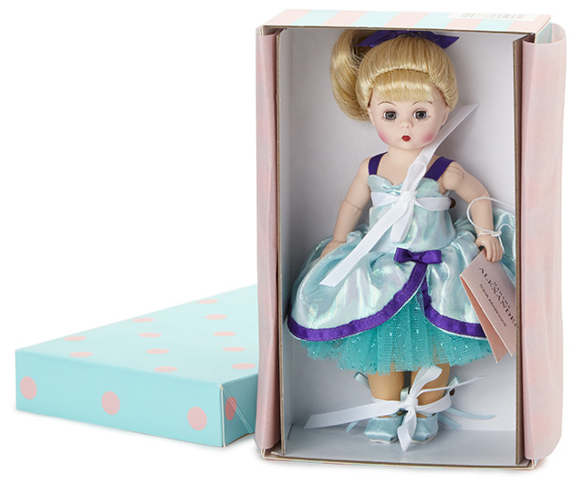Aqua Arabesque is an 8-inch Wendy sculpt with blue eyes and blond hair in a bun, on an articulated body. The dancer wears a satin and tulle outfit with nude tights and ballet shoes with ribbon ties.