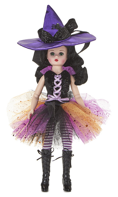 Magic Moonlight is a classic 10-inch Cissette in an enchanting new witch costume with ribbon-laced bodice, netting skirt, a purple satin peaked hat, striped tights, and laced boots. The doll has light skin tone with blue eyes and black hair.