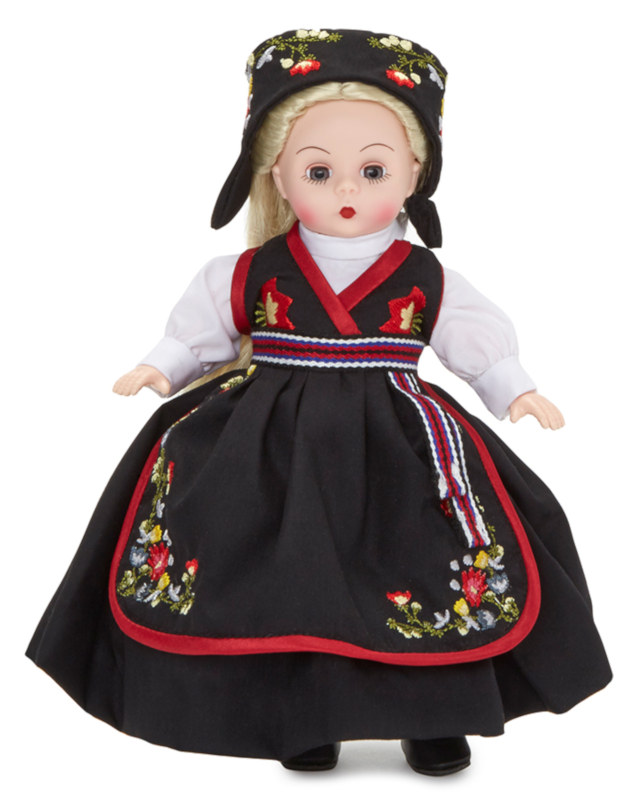 Norsk Prinsesse, part of Alexander's International collectible line, celebrates Norwegian heritage with a traditional embroidered outfit. The 8-inch Wendy doll has light skin tone with blue eyes and blond hair.