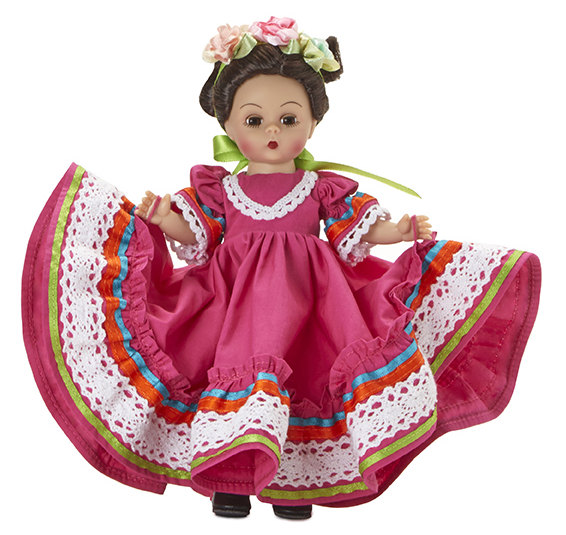 Princesa Mexicana is an 8-inch Wendy wearing a traditional folklorico dress trimmed with ribbon and lace. The doll is offered in medium skin tone with brown eyes and brunette hair.