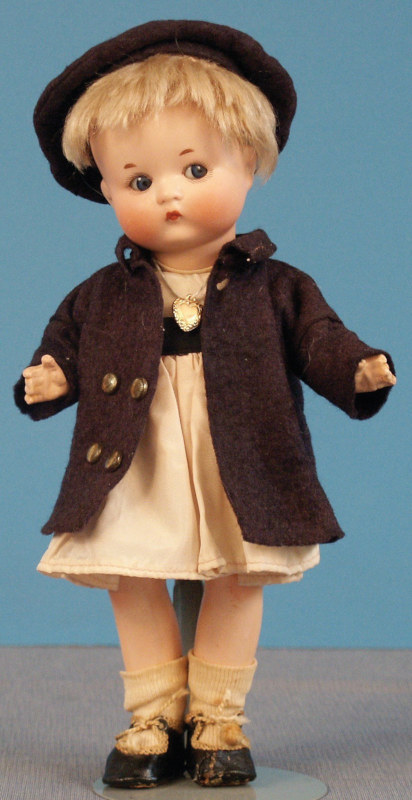 Fired-bisque Just Me doll, 9.5 inches, with original body, coat, hat, undies, shoes, and socks. Photo courtesy of Foulke Archives