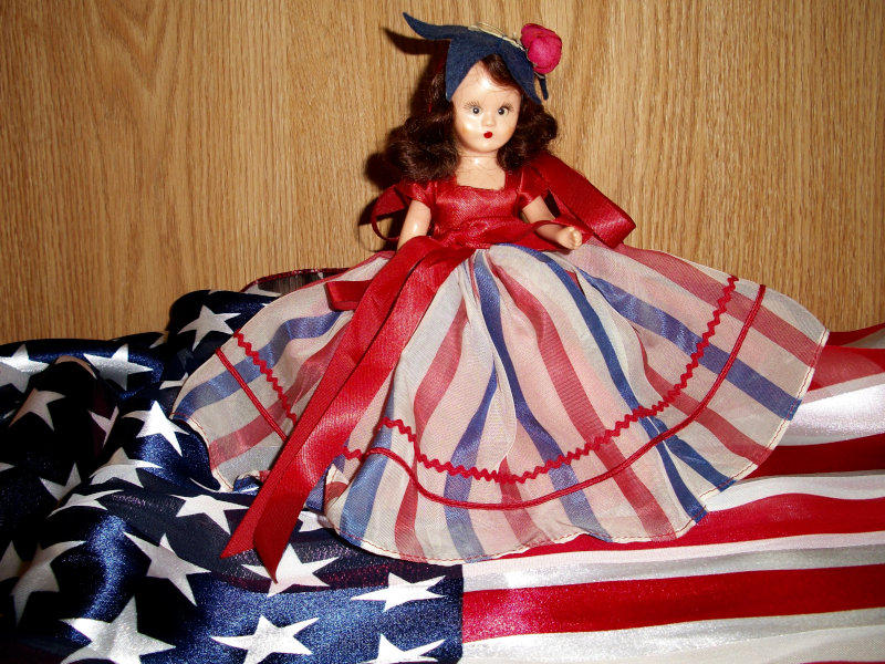 Beverly Hart: Nancy Ann Storybook #193 July, Doll of the Month, is ready to celebrate our independence in her red, white, and blue.
