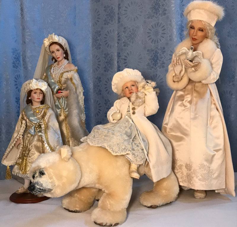 From left: Princess Anatasia and Queen Alexandra, both wax dolls by Crees and Coe; Snow Queen by Susan McMullen (woman holding bird with child on polar bear).