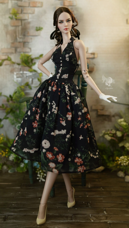 Lam in floral-print dress