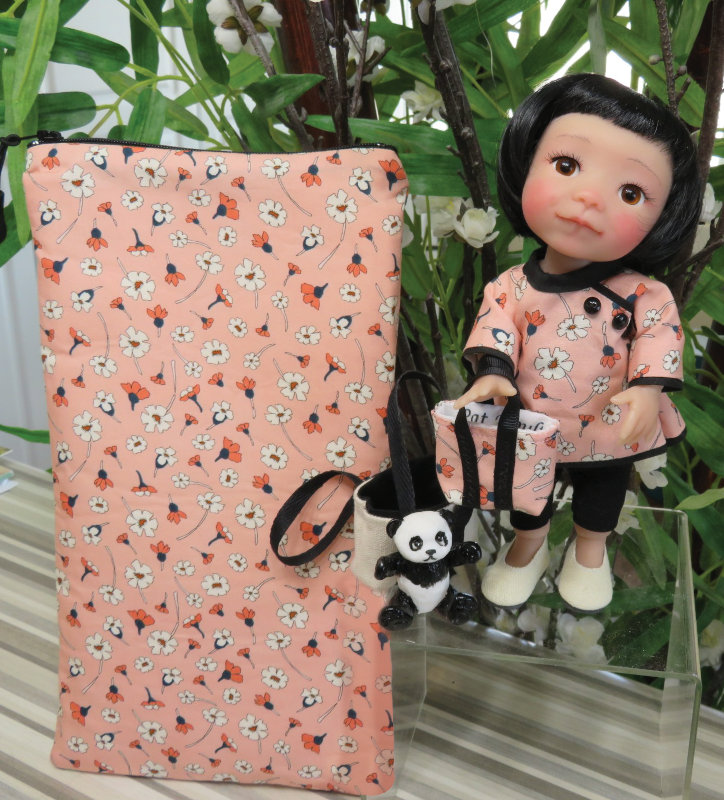 Pat Moulton's 8-inch BJD Lilly comes with face-up, two tote bags, resin panda, and zipper travel pouch all designed by the artist, and an outfit by Bonnie Larson of Wee Designs.