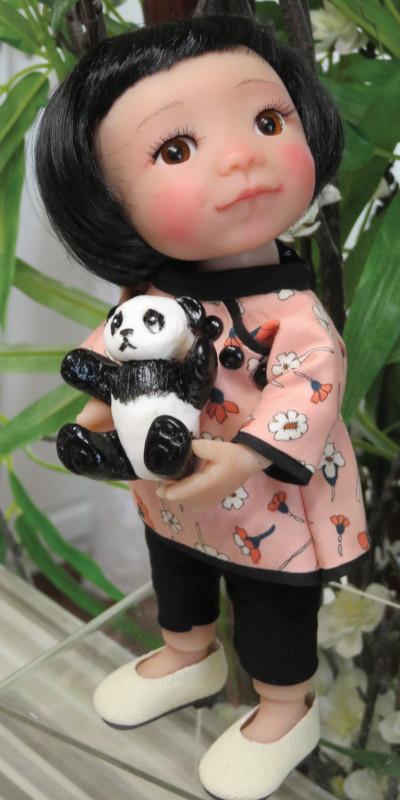 Moulton's Lilly BJD comes with a resin panda bear.