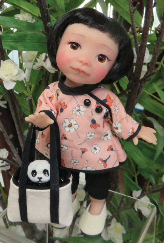 One of Lilly's tote bags is large enough to carry her panda pal.