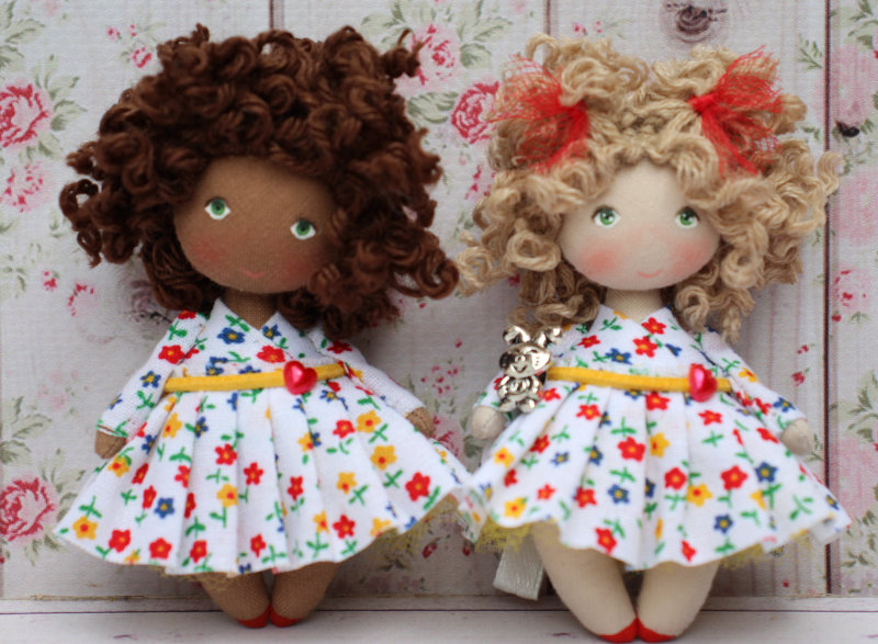 Two Moppet Dolls in matching outfits