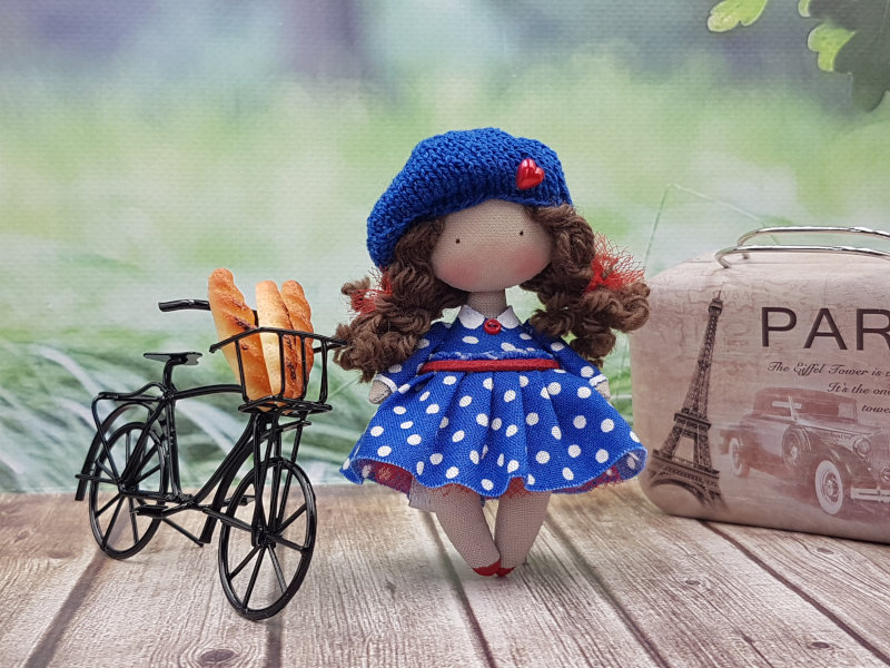 Moppet Doll with bicycle