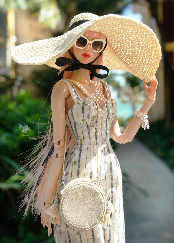 Lam in dress with hat