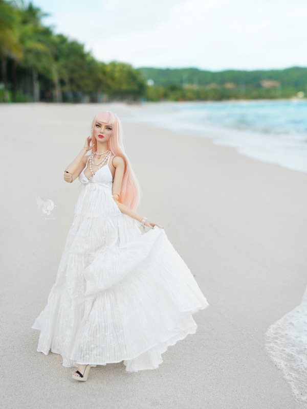Lam in a white dress at the beach