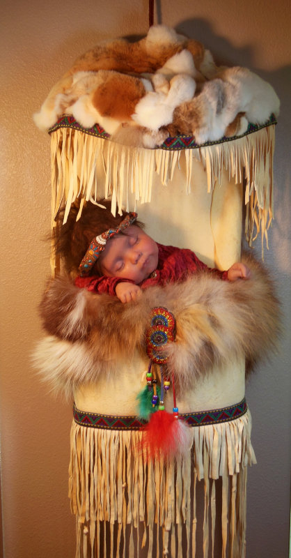 """RuBert's artist proof of her papoose doll (21 inches) has a cloth body with silicone head, arms, and legs. """"The doll and carrier will undergo changes until I am happy with the result,"""" the artist said."""