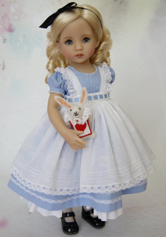 """""""This beautiful Alice in Wonderland doll was painted by me, and dressed and wigged by Alyson Miller,"""" Helen Skinner said. """"We did a few joint projects together with the vinyl Darlings."""""""