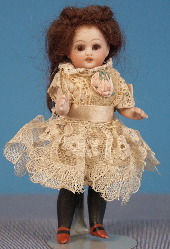 Simon & Halbig all-bisque doll with long black molded stockings and brown shoes.